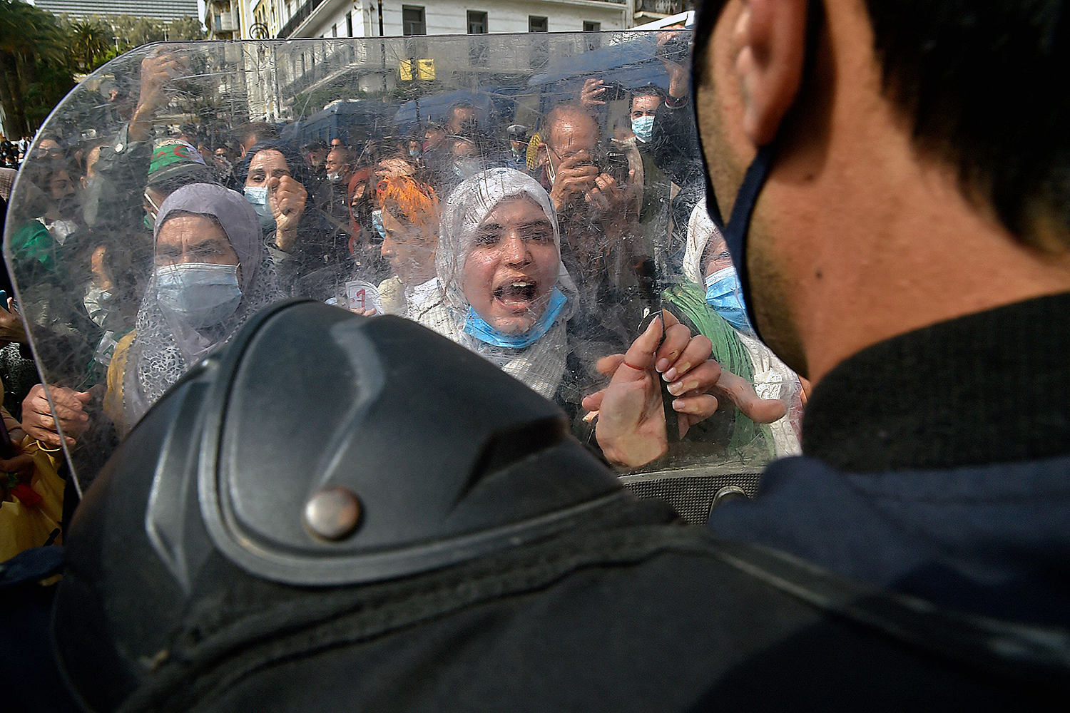 Algerian women chant slogans during an anti-government protest in Algiers on March 8. RYAD KRAMDI/AFP via Getty Images