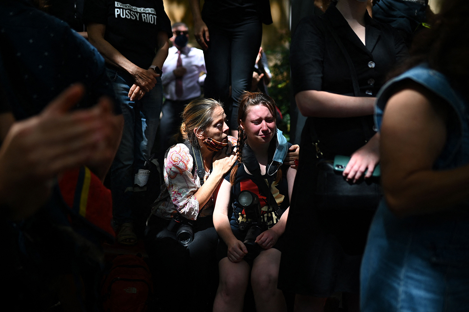 A protester is comforted during a rally against sexual violence and gender inequality in Sydney on March 15. STEVEN SAPHORE/AFP via Getty Images