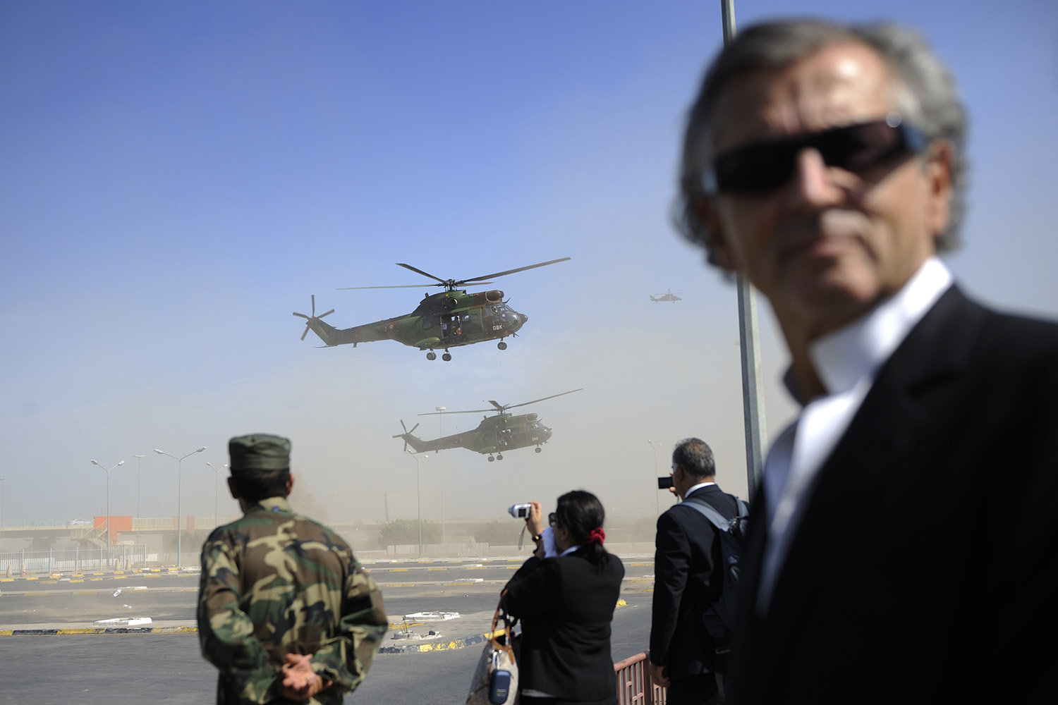 Bernard-Henri Levy with military helicopters in Libya in 2011.