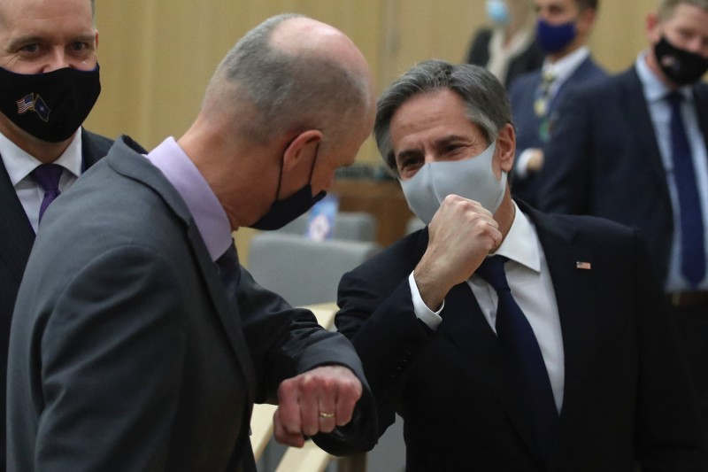 U.S. Secretary of State Antony Blinken (right) bumps elbows with the Netherlands' Foreign Minister Stef Blok.