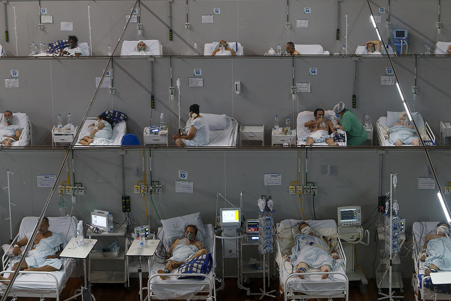 Brazilian coronavirus patients are set up in a field hospital at a sports gym in Santo Andre, Sao Paulo, on March 26. MIGUEL SCHINCARIOL/AFP via Getty Images