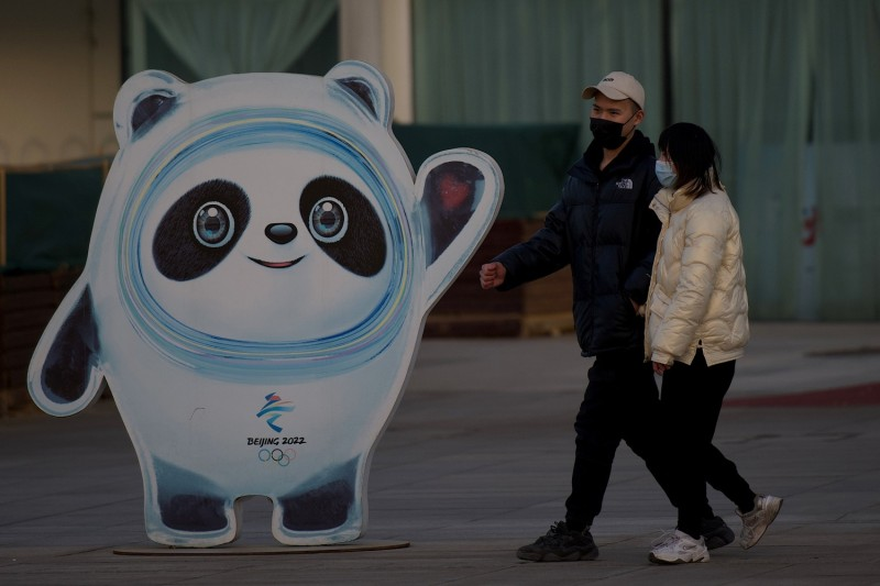 People walk past a panda mascot called Bing Dwen Dwen near the Bird's Nest stadium, the venue for opening and closing ceremonies at the 2022 Winter Olympics in Beijing, on Feb. 4.