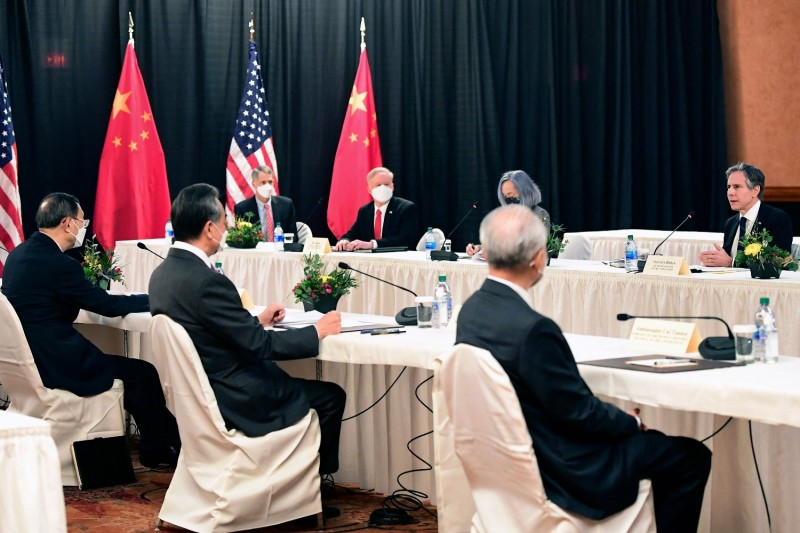 U.S. and Chinese officials meet at the opening session of talks at the Captain Cook Hotel in Anchorage, Alaska, on March 18.