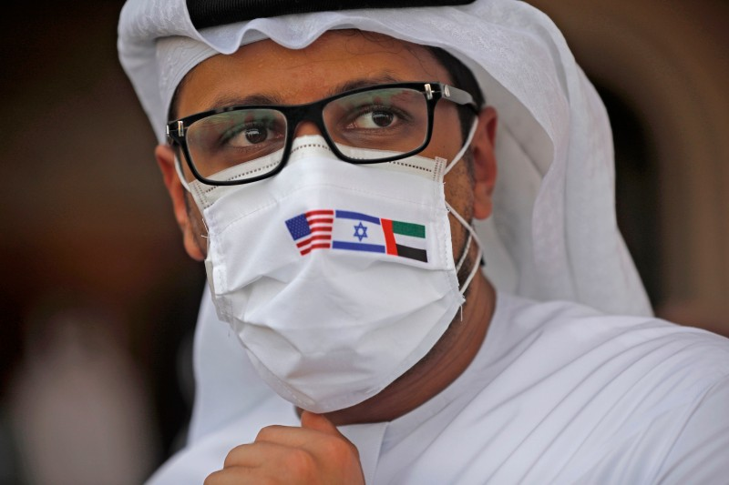 An Emirati man wears a protective mask with the flags of the United States, Israel, and the United Arab Emirates, on Aug. 31, 2020.