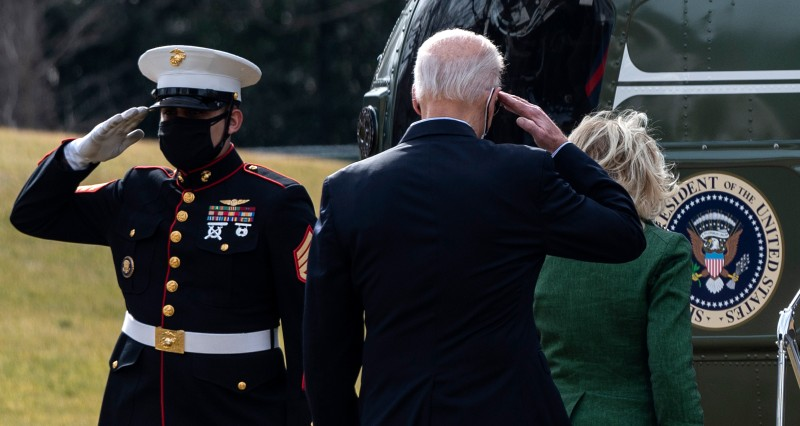 President Joe Biden and First Lady Jill Biden walk to Marine One.
