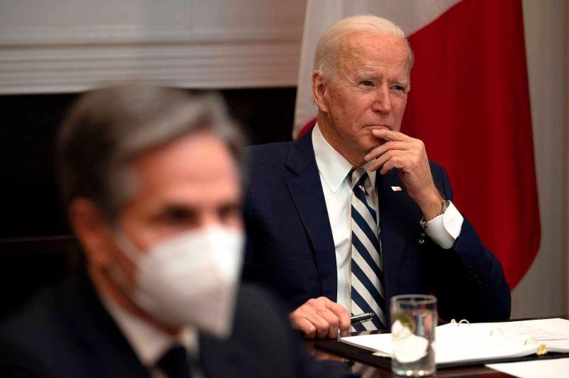 U.S. President Joe Biden, flanked by U.S. Secretary of State Antony Blinken