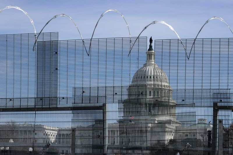 A temporary fence surrounds the U.S. Capitol