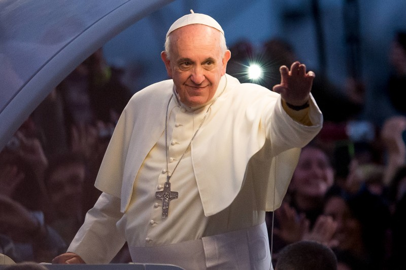 Pope Francis waves from the Popemobile on his way to attend the Via Crucis on Copacabana Beach during World Youth Day celebrations on July 26, 2013 in Rio de Janeiro.
