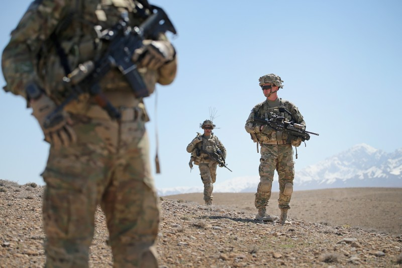 U.S. Army soldiers look for enemy rocket positions in Afghanistan.