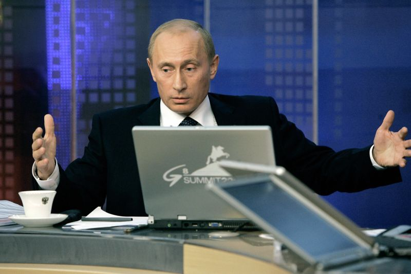Vladimir Putin gestures as he speaks at a Kremlin workshop in Moscow on July 6, 2006.