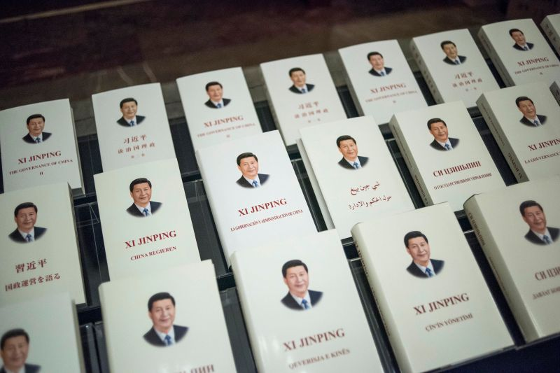 Chinese President Xi Jinping's book, translated into foreign languages, is on display during the opening ceremony of a high-level meeting held by the Chinese Communist Party at the Great Hall of the People in Beijing, on Dec. 1, 2017.