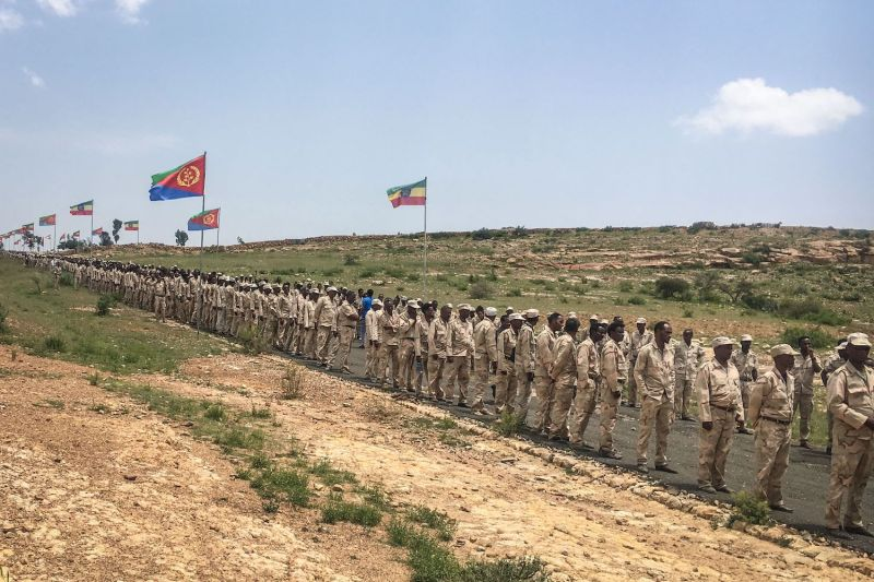 Eritrean soldiers wait in line to cross the border to attend a reopening ceremony with Ethiopia in Serha, Eritrea, on Sept. 11, 2018.