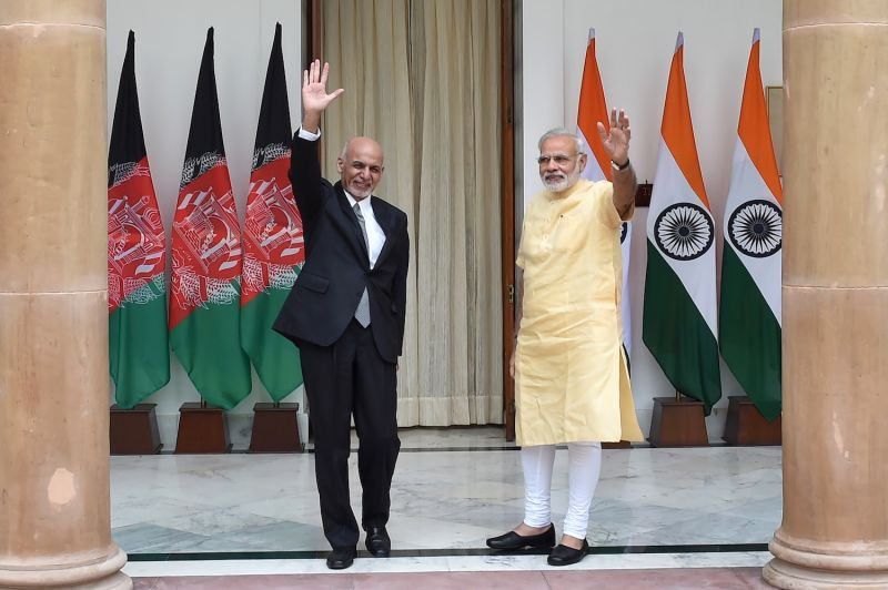 Afghan President Ashraf Ghani and Indian Prime Minister Narendra Modi wave prior to a meeting in New Delhi on Sept. 14, 2016.