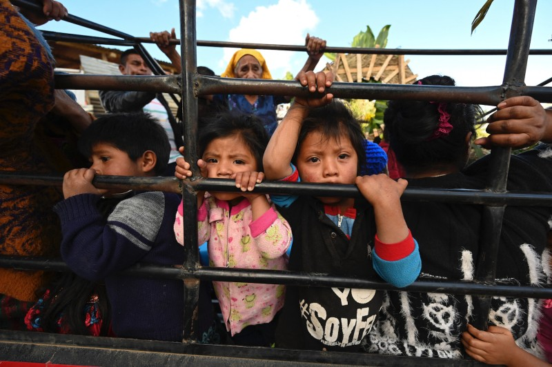 Children attend the funeral of Rubelsy Tomas Isidro, a Guatemalan migrant murdered alongside 18 other people in the northern Mexican state of Tamaulipas last month, in Comitancillo, Guatemala, on March 13.