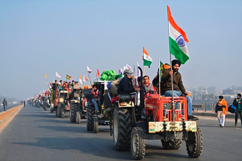Farmers take part in a tractor rally as they continue to demonstrate against the central government's recent agricultural reforms in New Delhi on Jan. 26.