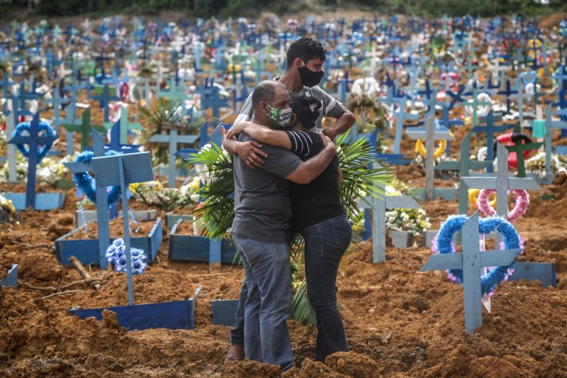 Relatives of a deceased person mourn during a mass burial of coronavirus pandemic victims at the Parque Tarumã Cemetery in Manaus, Brazil on May 19, 2020.