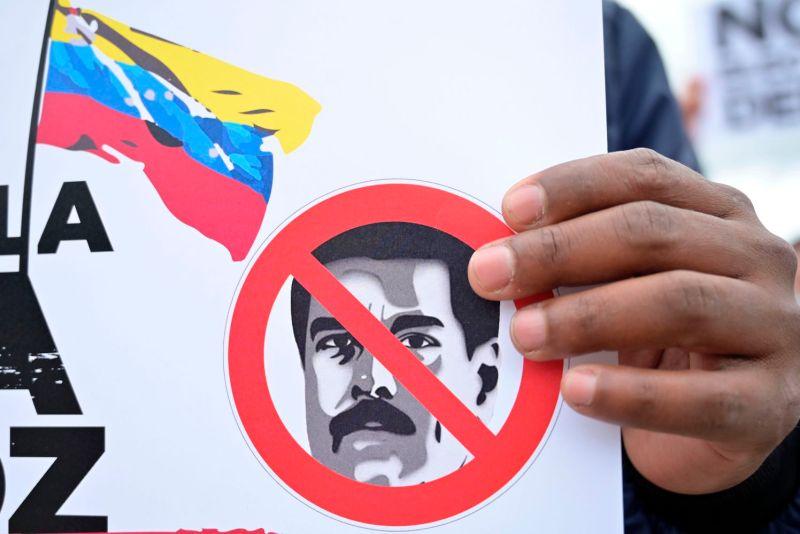 Venezuelan citizens living in Colombia demonstrate prior to Venezuelan legislative elections in Bogotá, on Dec. 6, 2020.