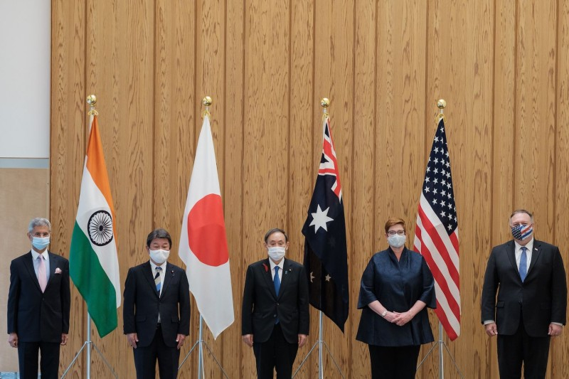 Indian Foreign Minister Subrahmanyam Jaishankar, Japanese Foreign Minister Toshimitsu Motegi, Japanese Prime Minister Yoshihide Suga, Australian Foreign Minister Marise Payne, and U.S. Secretary of State Mike Pompeo pose for photographs before a Quad Indo-Pacific meeting in Tokyo on Oct. 6, 2020.