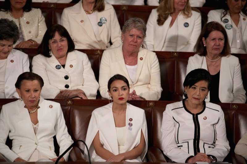 Members of Congress wear white to honor the women's suffrage movement and support women's rights as U.S. President Donald Trump addresses a joint session of the U.S. Congress on Feb. 28, 2017.