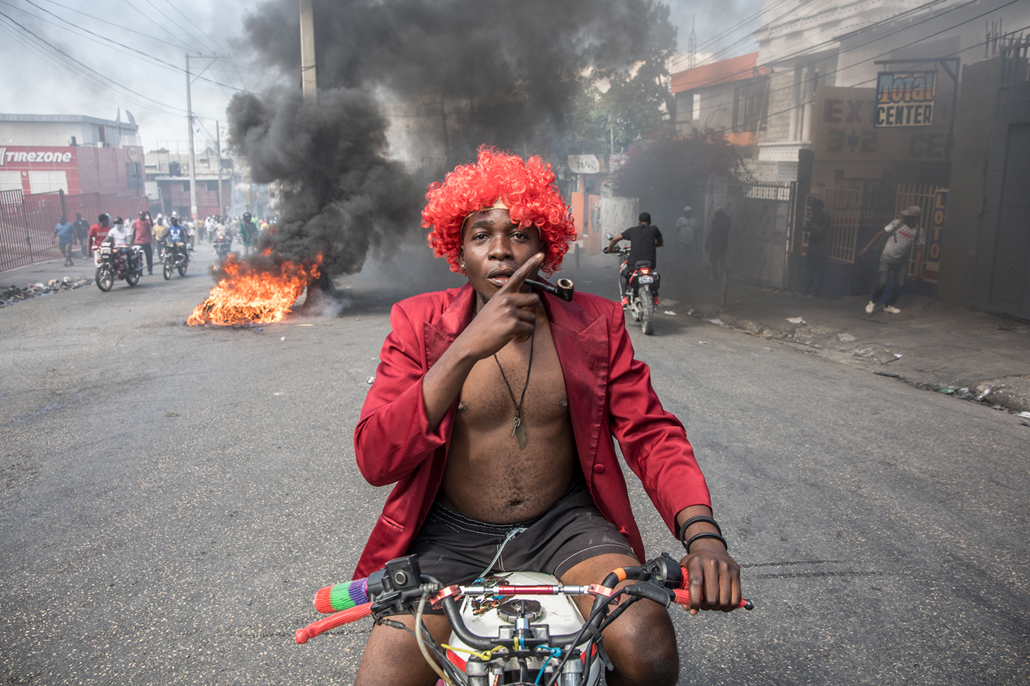 Demonstrators march in Port-au-Prince, Haiti, on Feb. 14 to protest against the government of President Jovenel Moise. VALERIE BAERISWYL/AFP via Getty Images