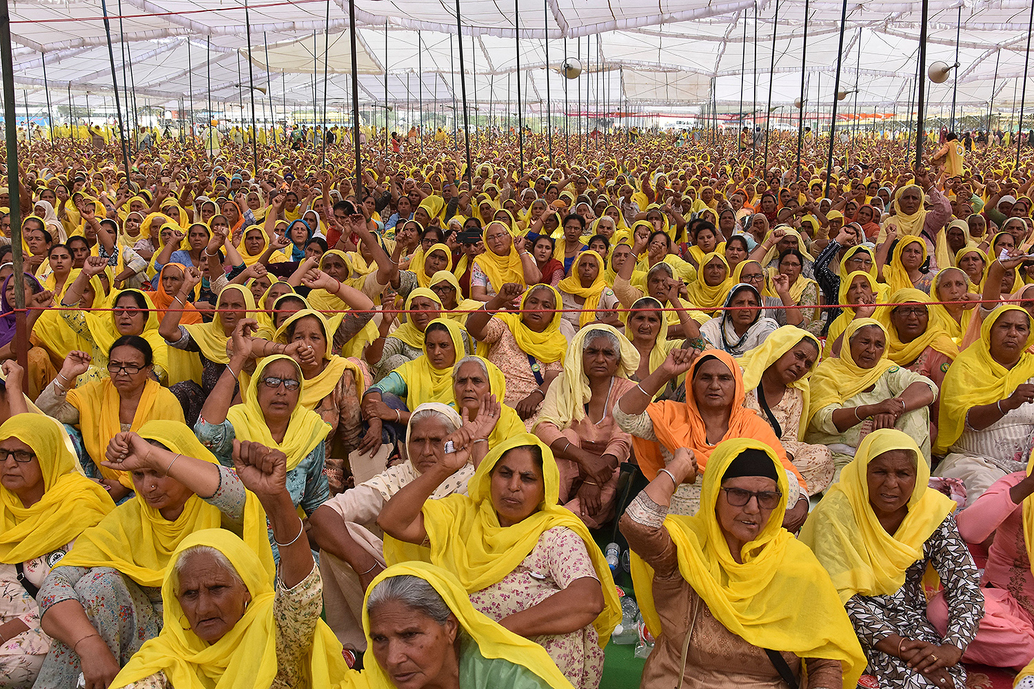 Female farmers shout slogans as they demonstrate against the central government's recent agricultural reforms on International Women's Day, March 8, at the Tikri border in Bahadurgarh, Haryana, India. AFP via Getty Images