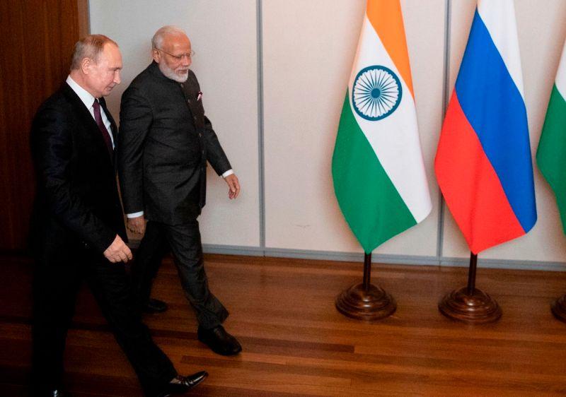 Russian President Vladimir Putin and Indian Prime Minister Narendra Modi meet in Brazil.