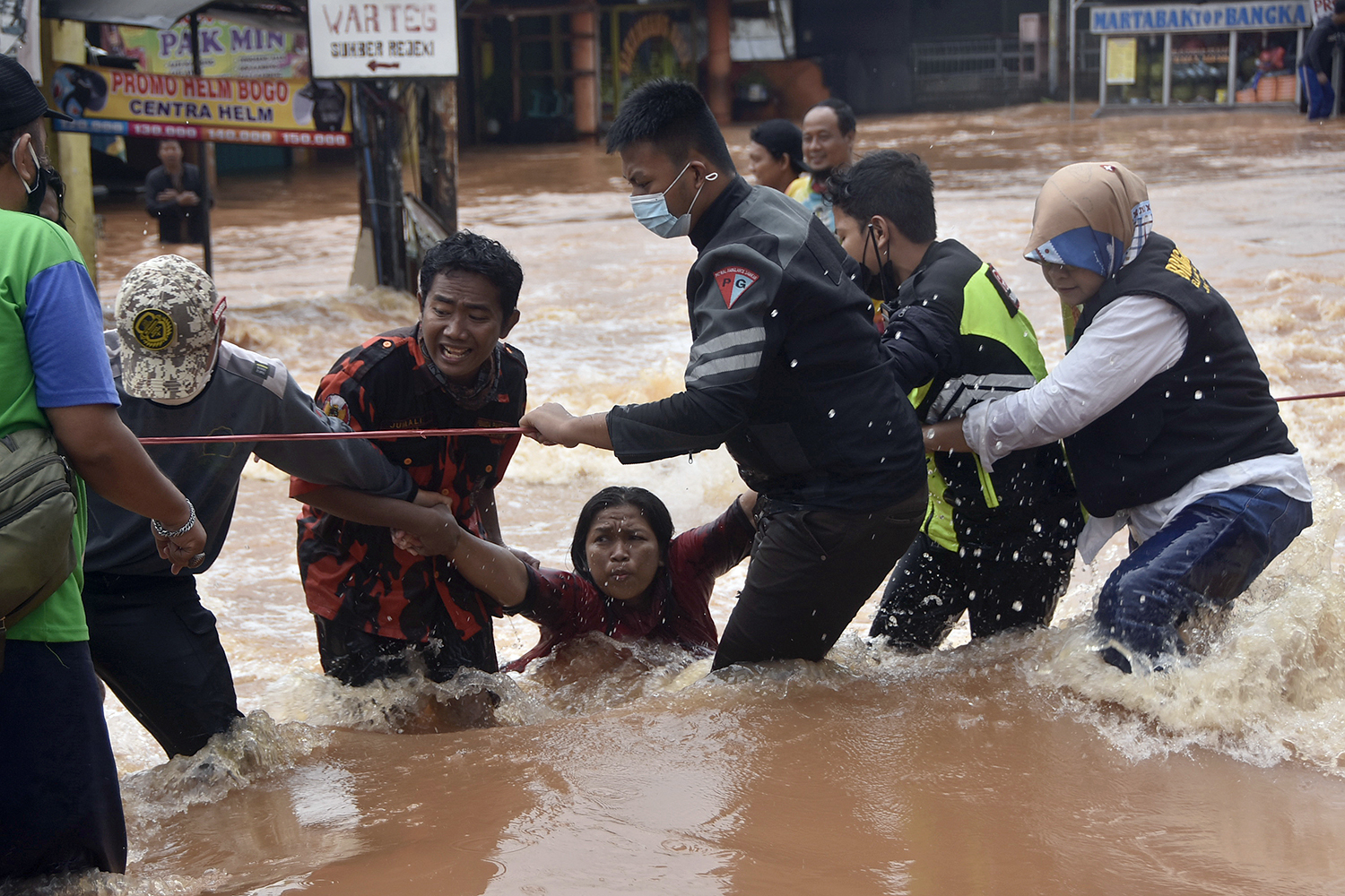 Rescue personnel assist residents in Bekasi, West Java, Indonesia, during massive flooding Feb. 20. REZAS/AFP via Getty Images