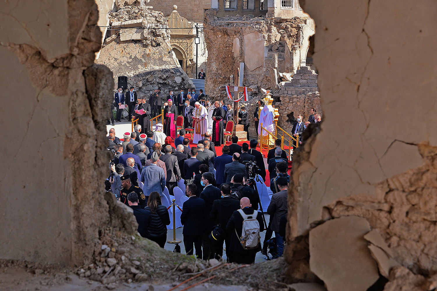 Pope Francis addresses Iraqis near the ruins of the Syriac Catholic Church of the Immaculate Conception in northern Mosul on March 7. Pope Francis was the first pope to visit Iraq, where he met with Christian communities that endured the brutality of the Islamic State. ZAID AL-OBEIDI/AFP via Getty Images