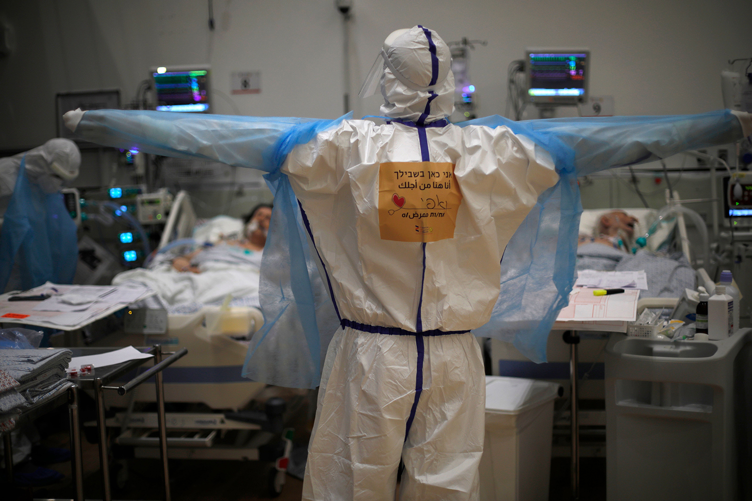 Medical personnel tend to COVID-19 patients in an isolation ward at the Ziv Medical Centre in Safed, Israel, on Feb. 2. JALAA MAREY/AFP via Getty Images