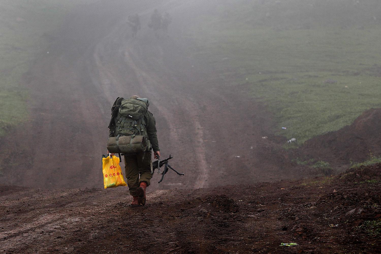 An Israeli soldier walks near Kibbutz Merom Golan in the Israeli-annexed Golan Heights on March 1. JALAA MAREY/AFP via Getty Images