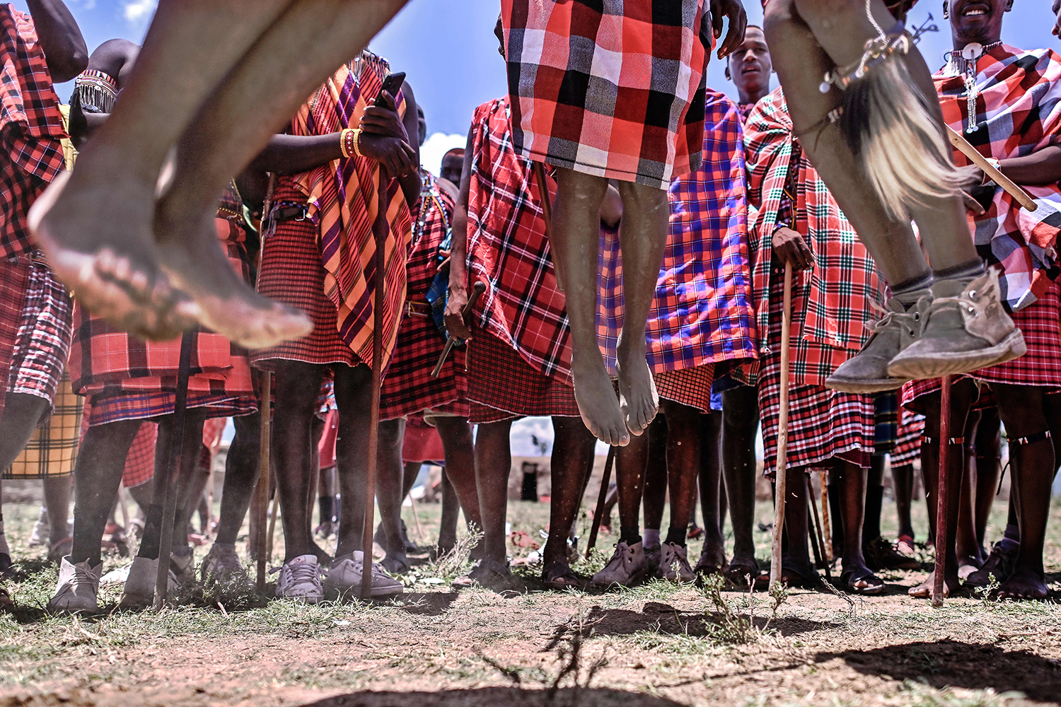 Men from the Kenyan Maasai tribe perform a traditional jumping ritual as they observe a rite of passage near Lemek town in Kenya's Narok County on Feb. 27. TONY KARUMBA/AFP via Getty Images