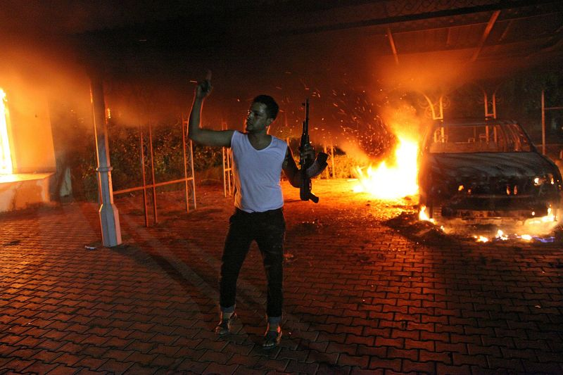 A car fire burns at the US consulate in Benghazi, Libya.