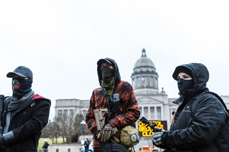 Right-wing militia members protest outside Kentucky Capitol building.