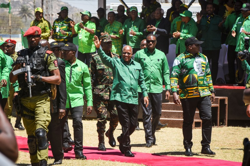 Tanzanian President John Magufuli greets crowds before a speech.