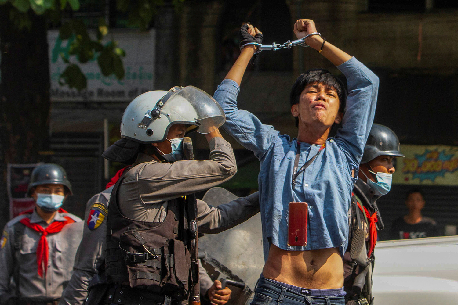 A pro-democracy protester is detained by riot police officers during a rally against the military coup in Yangon, Myanmar, on Feb. 27. Stringer/REUTERS