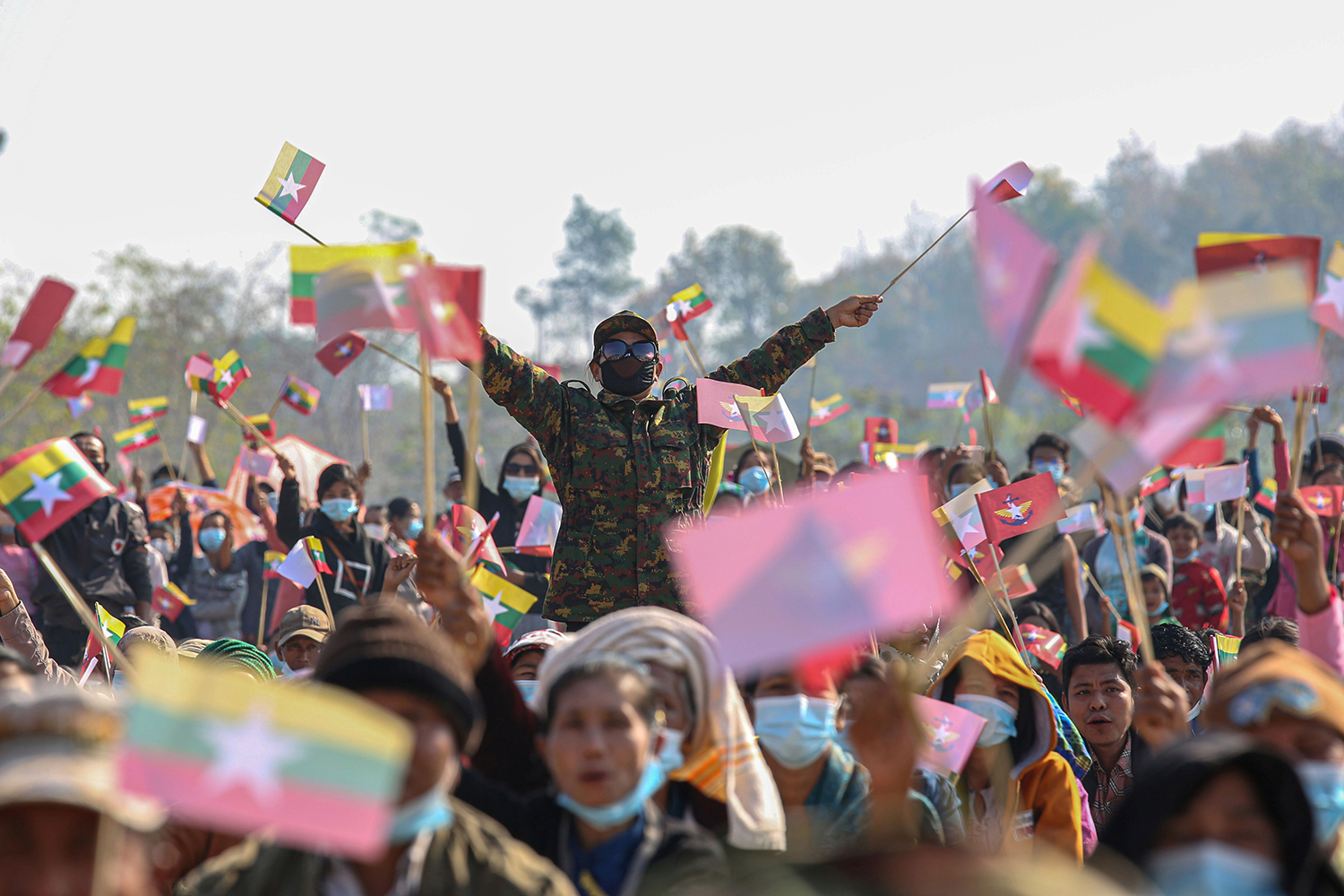 Army supporters waving the armed forces of Burma flag and the national flag participate in a rally in Naypyidaw, Myanmar, on Feb. 4 following a military coup that detained civilian leader Aung San Suu Kyi. STR/AFP via Getty Images