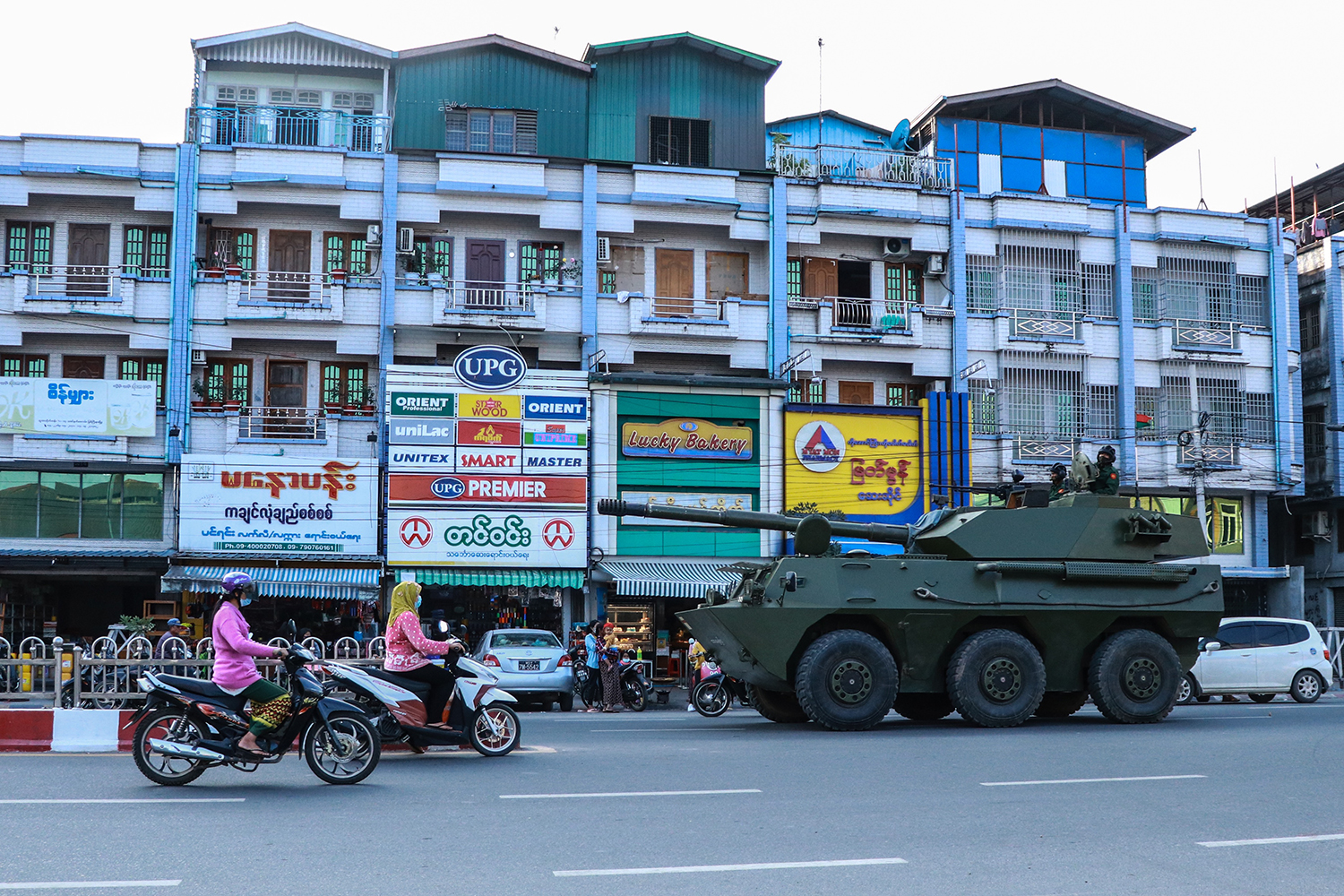 An armored vehicle rolls down a street in Myitkyina, Kachin State, Myanmar, on Feb. 2, a day after a military coup. STR/AFP via Getty Images