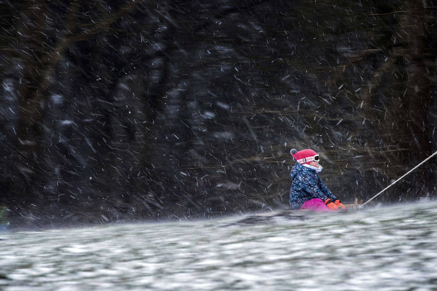 A child rides on a sled in Heiloo, Netherlands, on Feb. 7 during the country's first snowstorm in 10 years. KOEN VAN WEEL/ANP/AFP via Getty Images