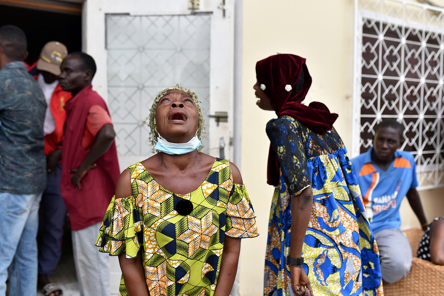 Women cry after hearing that Democratic Republic of the Congo presidential candidate Guy Brice Parfait Kolelas died from COVID-19 at the Union of Humanist Democrats offices in Brazzaville on March 22. Olivia Acland/REUTERS
