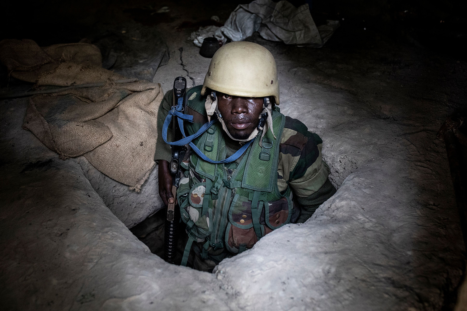 A member of the Senegalese Armed Forces emerges from an underground bunker at a recently captured Movement of Democratic Forces of Casamance rebel base on Feb. 9. The conflict in Casamance, which is separated from the rest of Senegal by Gambia, has claimed thousands of lives since it first broke out in 1982. JOHN WESSELS/AFP via Getty Images