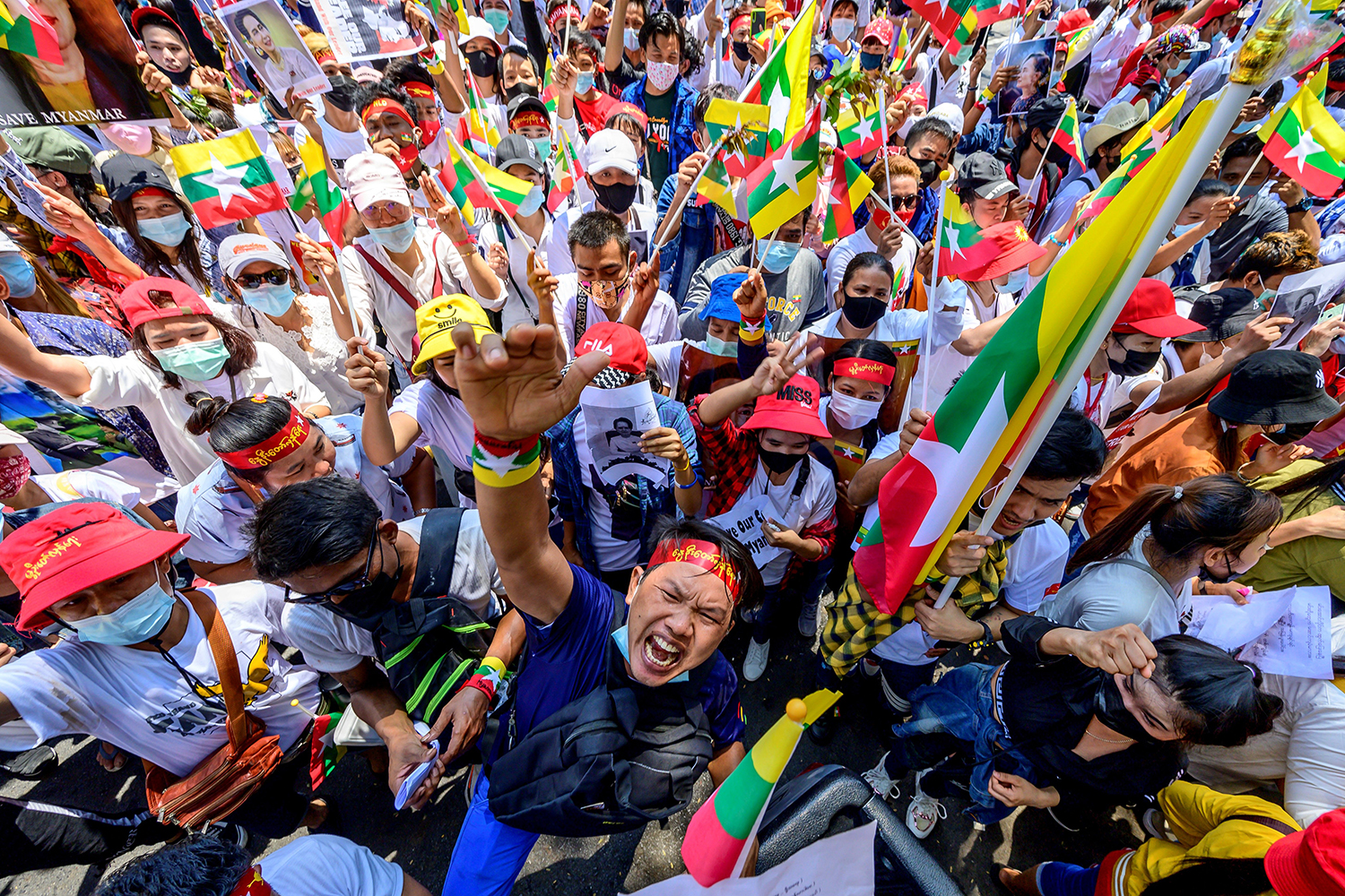 Myanmar migrants in Thailand shout slogans at a protest against the military coup in their home country in front of the United Nations ESCAP building in Bangkok on March 7. MLADEN ANTONOV/AFP via Getty Images