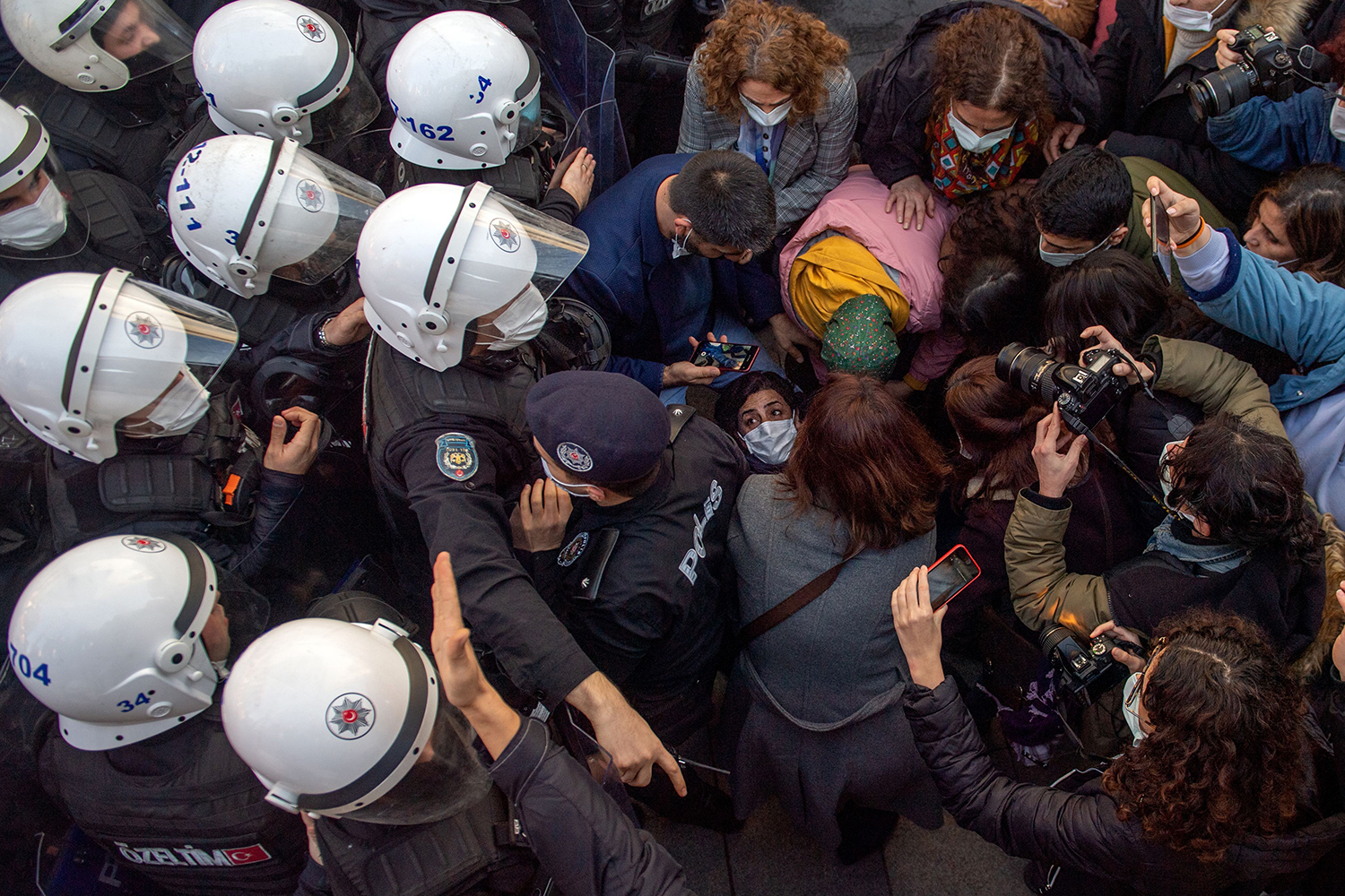 Turkish police officers detain protesters fighting against the appointment of Melih Bulu, a ruling Justice and Development Party loyalist, as the new rector of Bogazici University in Istanbul on Feb. 4. BULENT KILIC/AFP via Getty Images