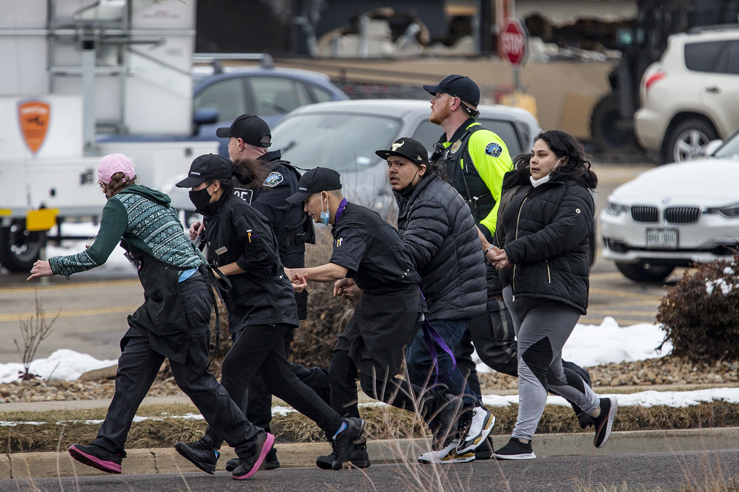 Shoppers are evacuated from a King Soopers grocery store in Boulder, Colorado, after a gunman opened fire March 22. Ten people, including a police officer, were killed. Chet Strange/Getty Images