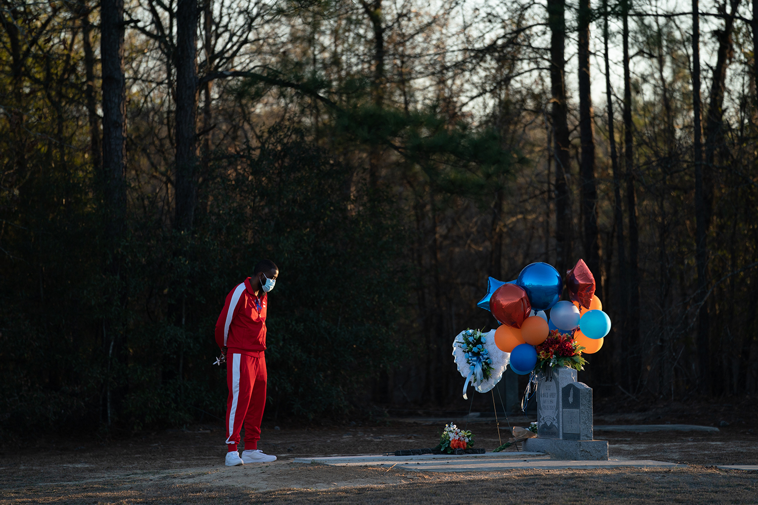 Bianca Dorsey visits the gravesite of Ahmaud Arbery during a candlelight vigil at New Springfield Baptist Church in Waynesboro, Georgia, on Feb. 23. Arbery, a Black man, was shot and killed while jogging near Brunswick, Georgia, in 2020 after being chased by two white men. Sean Rayford/Getty Images