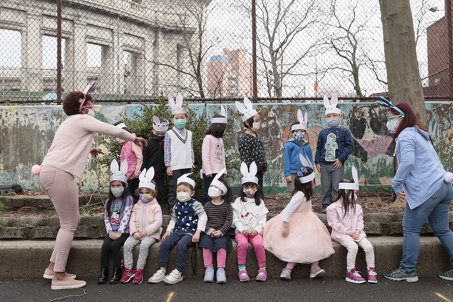 Teachers help organize kindergarten and prekindergarten students for a class portrait at Yung Wing Elementary School in New York City on March 25. Michael Loccisano/Getty Images