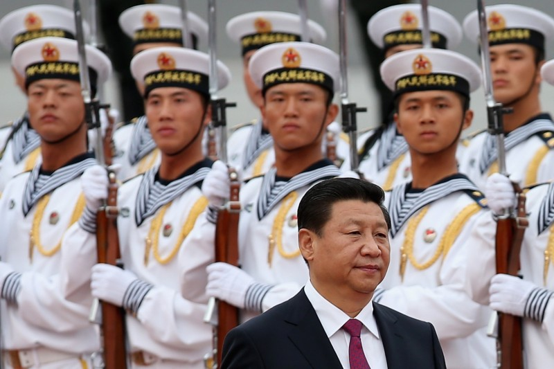 A guard of honor looks at Chinese president Xi Jinping