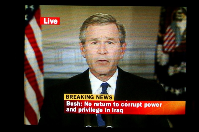 A television screen in the control room of ITV broadcasts a live address by then-U.S. President George W. Bush announcing the capture of Iraqi dictator Saddam Hussein in London on Dec. 14, 2003.
