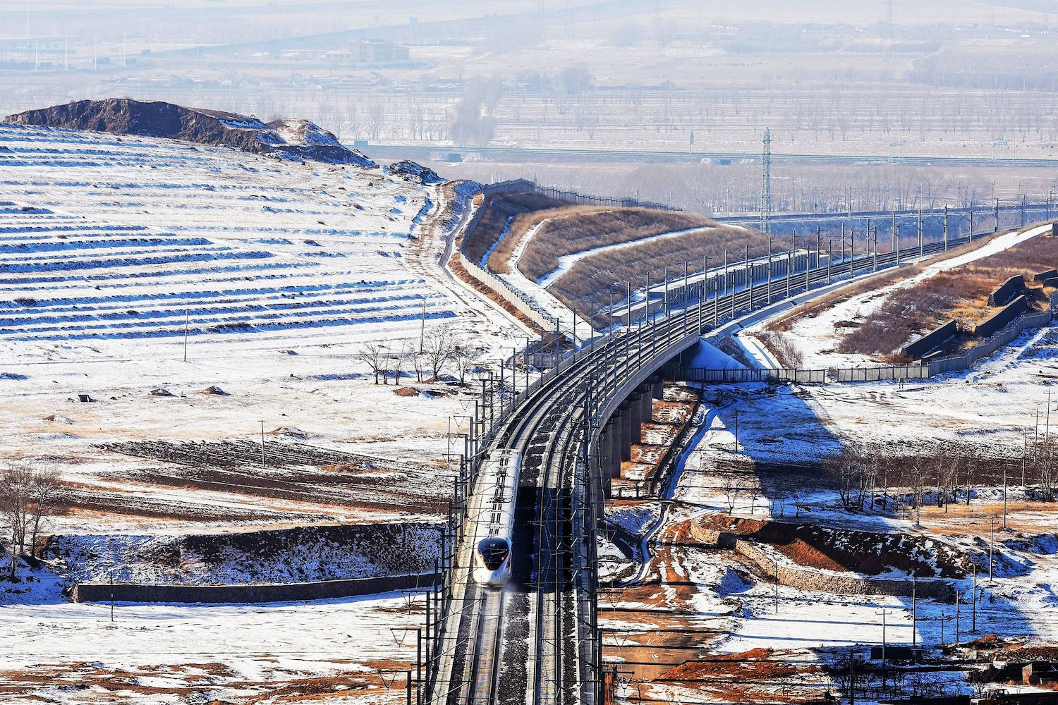 A bullet train undergoes a test run between Beijing and Hohhot in China's northern Inner Mongolia region on Dec. 9, 2019.