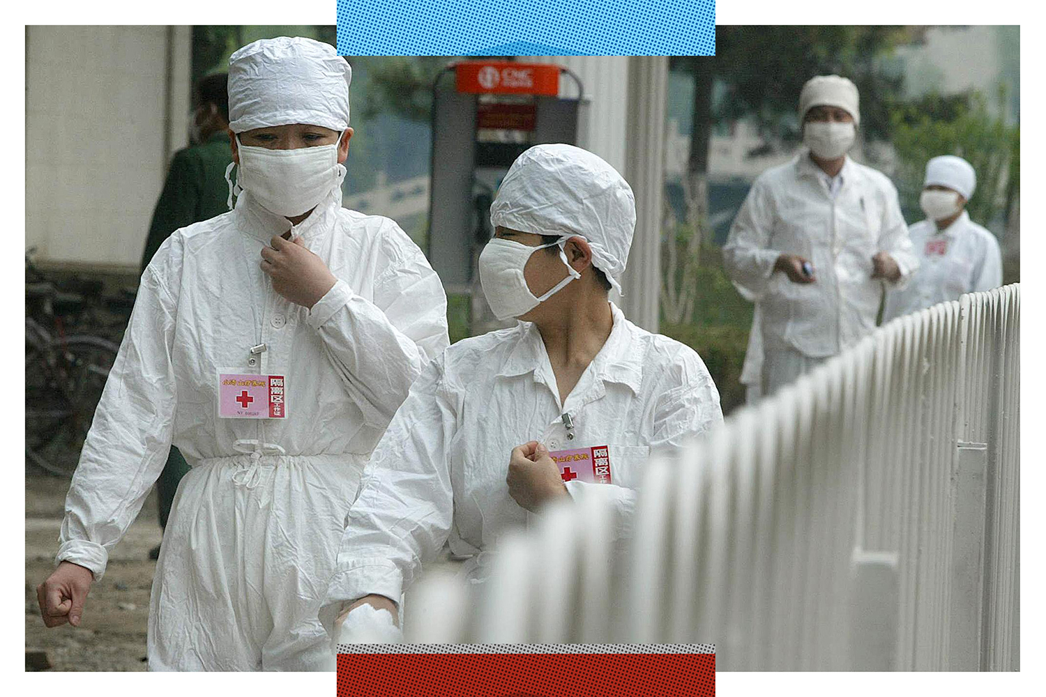 Nurses walk behind a barricade at the quarantined Severe Acute Respiratory Syndrome (SARS) facility of Xiaotangshan hospital on the outskirts of Beijing on May 7, 2003.