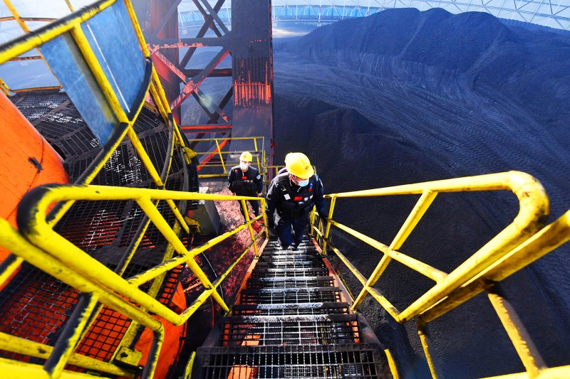 Policemen inspect the facilities at a coal mine in Changji in northwest China's Xinjiang Uygur Autonomous Region on Feb. 21.